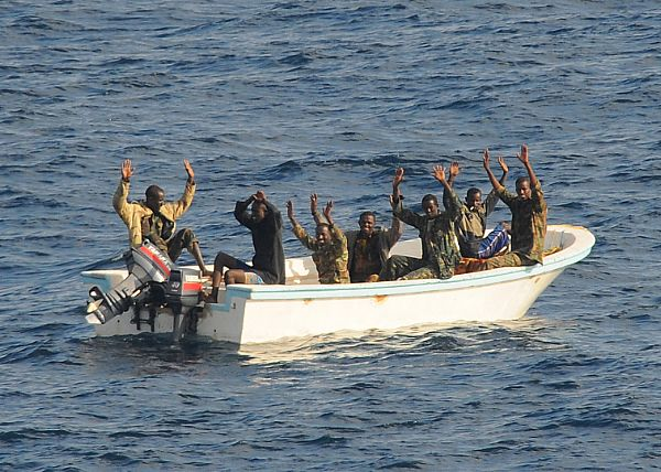 Comin' to Getcha. Suspected pirates in Gulf of Aden surrender to the USS Vella Gulf in 2009. US Navy photo