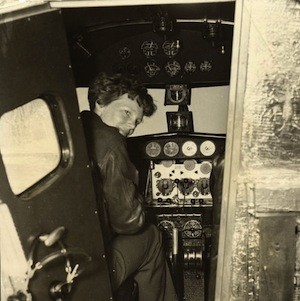 Earhart in the Electra cockpit, c. 1936.