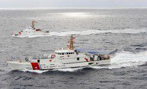MIAMI - The Coast Guard Cutter Nantucket keeps pace with Miami's newest cutter, the Bernard C. Webber, during its arrival at Coast Guard Sector Miami Feb. 9, 2012. The Webber is named after Coast Guard hero Bernard C. Webber, who is credited for his assistance during the rescue of 33 of the tanker vessel Pendleton's 34 crewmembers. U.S. Coast Guard photo by Petty Officer 1st Class Jennifer Johnson.