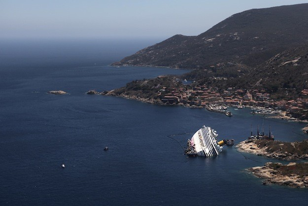 The Costa Concordia wrests on it&#039;s side on the Island of Giglio. Photo: