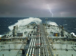 A double hulled VLCC headed for the eye or the storm. Image (c) Shutterstock/Montenegro