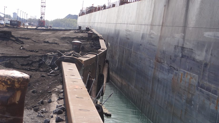 A dock located at Arcelor Mittal in Burns Harbor, Ind., buckled during an offload of product of the motor vessel Algoma Transport, Sept. 25, 2012. Photo: U.S. Coast Guard photo by Lt. Leslie Downing.