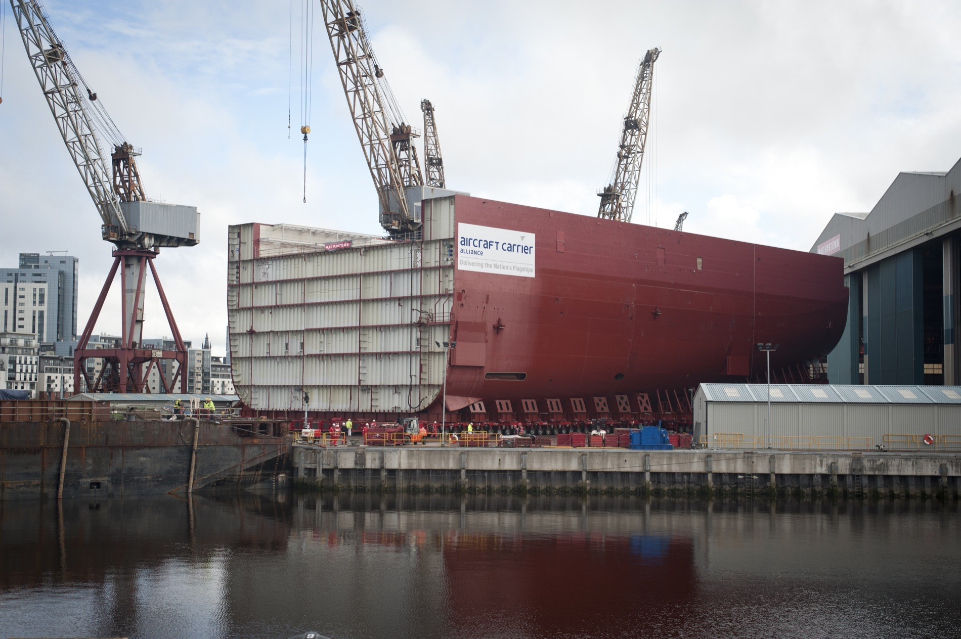 Nation&#039;s flagship is on the move - Lower Block 04, the biggest hull section of HMS Queen Elizabeth at 11,300 tonnes, is rolled out of the shipbuild halls at BAE Systems&#039; Govan yard on the Clyde ahead of her journey to Rosyth. Photo (c) BAE System&#039;s