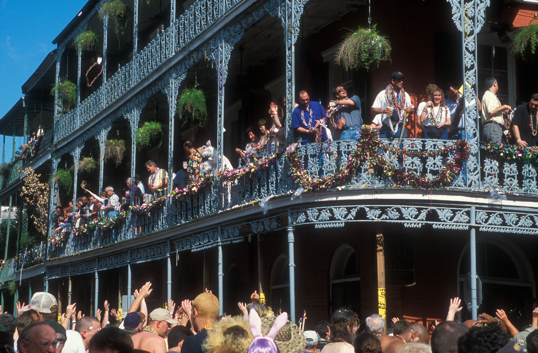 A balcony on Bourbon Street during Mardi Gras. Photo (c) Alex Demyan