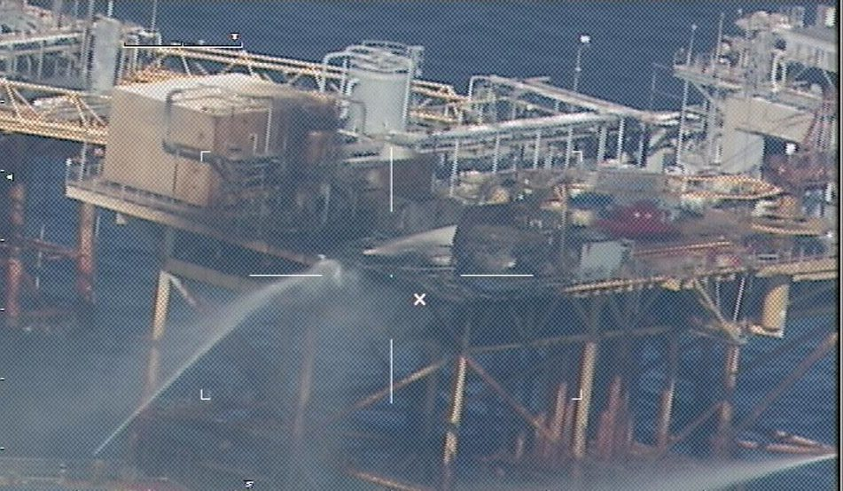 GULF OF MEXICO - Commercial vessels spray water to extinguish a platform fire on board West Delta 32 approximately 20 miles offshore Grand Isle, La., in the Gulf of Mexico. First responders medevaced nine of the platform's 22 personnel to nearby rigs. U.S. Coast Guard photo.