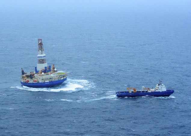 The tug Nanuq and the tug Aiviq (not pictured) tow the mobile drilling unit Kulluk in 15 to 20-foot seas. U.S. Coast Guard photo by Petty Officer 1st Class Sara Francis.