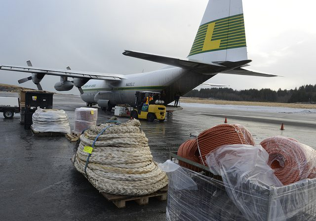 Workers prepare equipment and supplies on the airport tarmac in Kodiak Thursday, Jan. 4 to be used in the ongoing Kulluk response and recovery effort. Photo by Greg Martin via KullukResponse.com