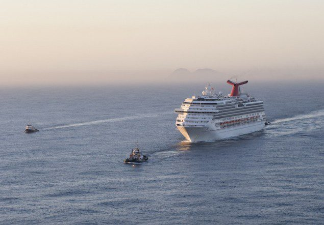 SAN DIEGO – The Carnival Cruise Ship Splendor is towed into San Diego Bay, Nov. 11, 2010. The cruise ship became disabled after a fire in the engine room, Monday, Nov. 8, 2010. U.S. Coast Guard photo.