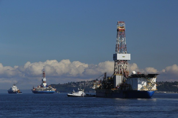 Shell's Kulluk and Discoverer rigs set sail for the Arctic in July 2012 from Vigor Industrial's Seattle shipyard. Image courtesy Vigor Industrial