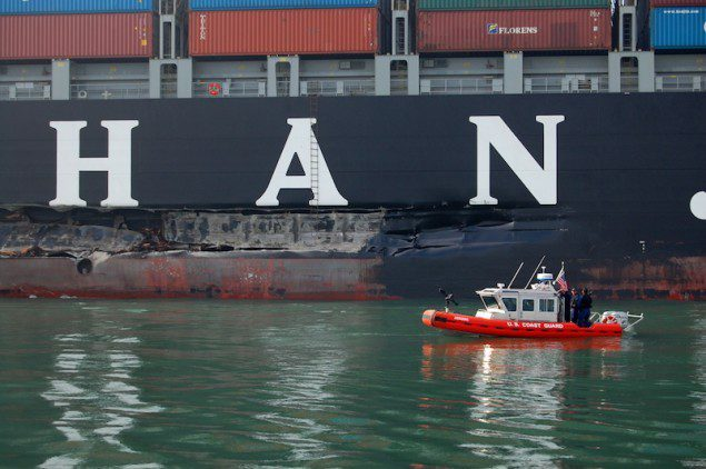 A U.S. Coast Guard boat inspects the 100-foot gash in the hull of the Cosco Busan, which resulted in the release of an estimated 53,000 gallons of oil. U.S. Coast Guard Photo